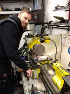 alex working on the lathe traxden motorcycles